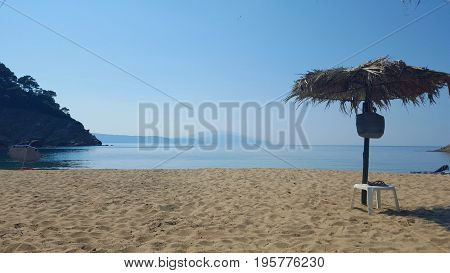 Beautiful Micros Aselinos beach on Skiathos island in Greece umbrella summer day in June