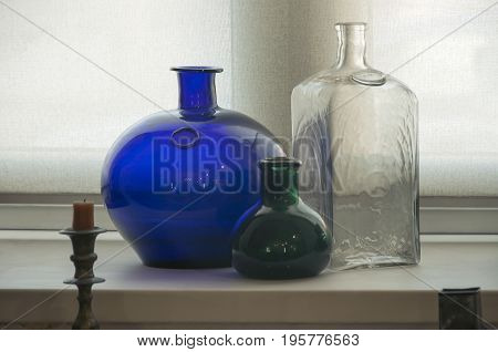 Interior of the old pharmacy Ancient glass chemist's ware.