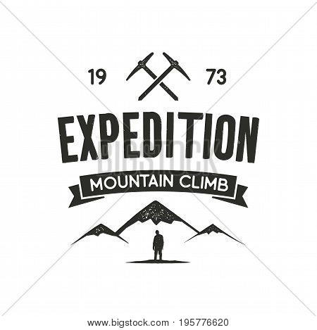 Mountain expedition label with climbing symbols and type design - mountain climb. Vintage letterpress style. Outdoor activity emblem for t-shirt, mug, clothing print. Vector isolated on white.