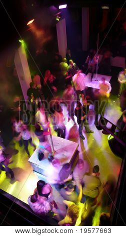 Nightclub dancefloor scene with dancing crowd in motion