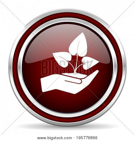 Hand protect plant growth red glossy icon. Chrome border round web button. Silver metallic pushbutton.