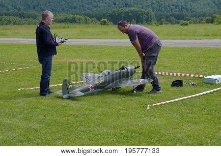 Penza Oblast, Russia - July 15, 2017: Radio control flying model of a aircraft World War II era. The Russian Aeromodelling Cup in Bolshoy Vyas village.