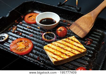 ofu on the grill on the table on a black background, view from the top