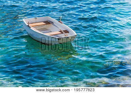 Small white wooden boat on Adriatic Sea Hvar Croatia