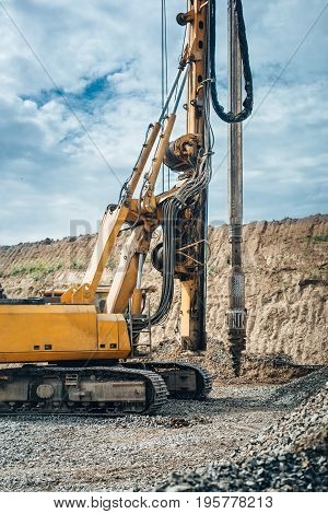 Industrial Drilling Rig Machinery On Highway Construction Site. Viaduct Construction And Bridge Pill