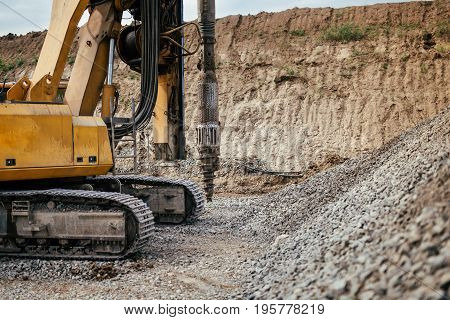 Close Up Details Of Heavy Duty Machinery On Construction Site. Detail Of Highway Building With Rotar