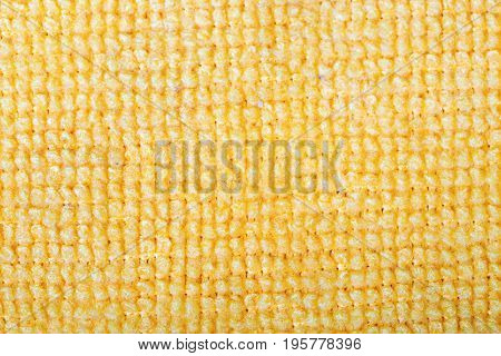 Yellow microfiber fabric texture background. Microfiber is recyclable synthetic fiber made from petrochemicals includes polyester and nylon