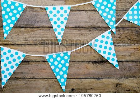 Blue And White Spotted Bunting Flags Hanging Against Rustic Timber Background