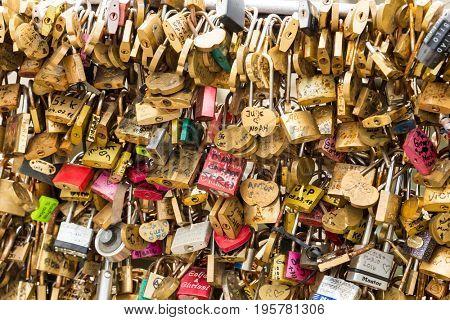 FRANCE, PARIS - April 01, 2017: Pont des arts - bridge across Seine river crammed with lovers padlocks on April 01, 2017