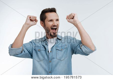 Enjoy your life. Joyful male keeping his mouth wide opened and posing isolated on white while looking sideways