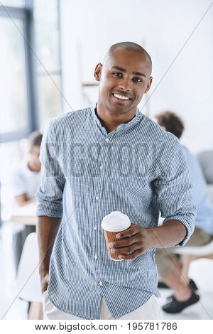 Portrait Of Smiling African American Businessman With Coffee To Go In Office
