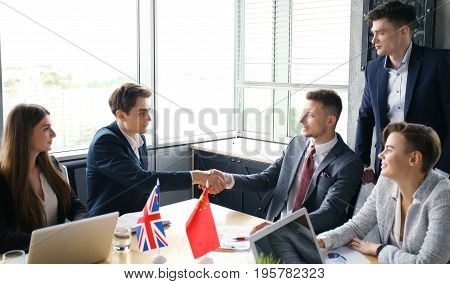 United Kingdom and Chinese leaders shaking hands on a deal agreement