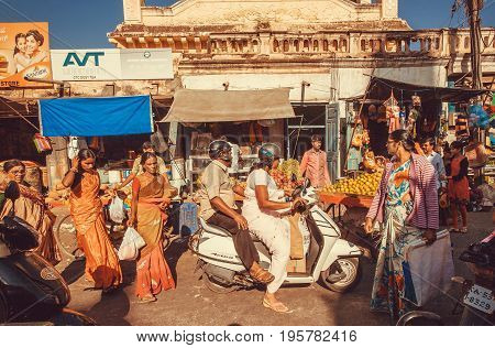 MYSORE, INDIA - FEB 18, 2017: Crowd of women and other customers and pedestrians around city market with shops stores and marketplaces on February 18, 2017. Mysore of Karnataka has a population of 900000