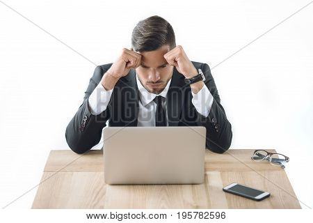 Portrait Of Tired Businessman Sitting At Workplace With Laptop And Smartphone Isolated On White