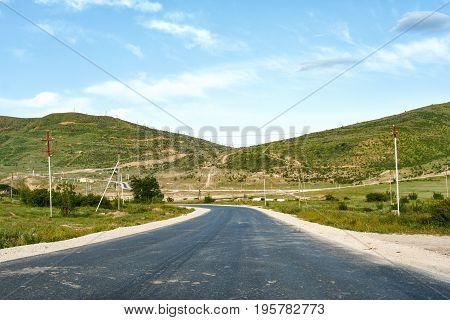 Winding asphalt road in a mountainous area