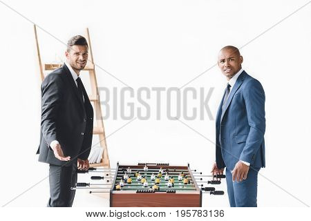 Side View Of Handsome Businessmen Playing Table Football Together