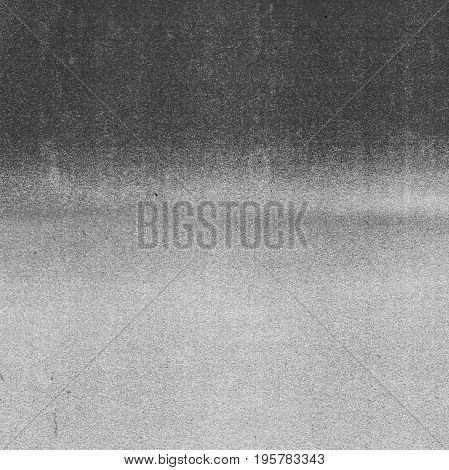Abstract grey photocopy texture background with feathered horizontal light/dark divide