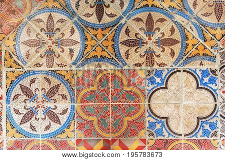 Example of retro design ceramic tile. Vintage patterned texture and background. Colonial house floor by old times.