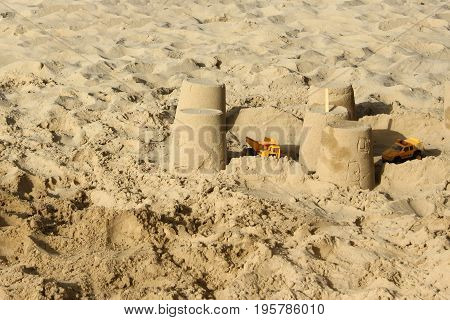 children's games in the sand on the beach
