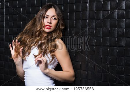 Portrait of playful sexy woman posing in the studio