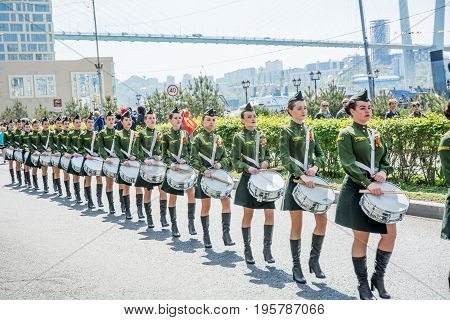a parade of women with the drums in military uniform, marching. May 9, 2017 year. Vladivostok, Russia.  on a sunny day