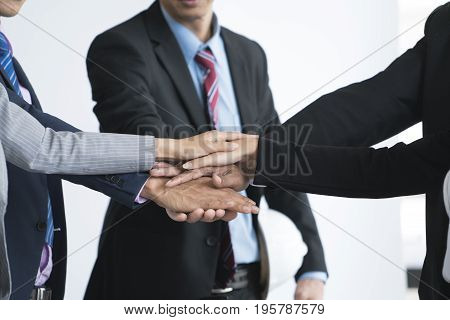 Businessmen and Businesswomen hand assemble corporate meeting teamwork concept successful