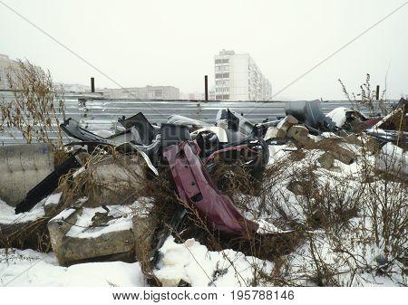 Large big garbage dump waste with snow
