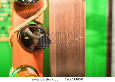 Close up wine bottle in wooden stand in restaurant
