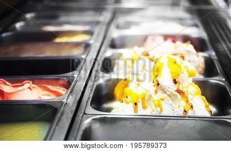 Gelateria - Mixed trays of ice cream in ice-cream shop close up