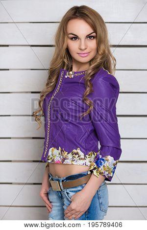 Portrait of attractive blonde wearing purple jacket