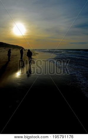 Northsea beach germany sunset very beautiful with people