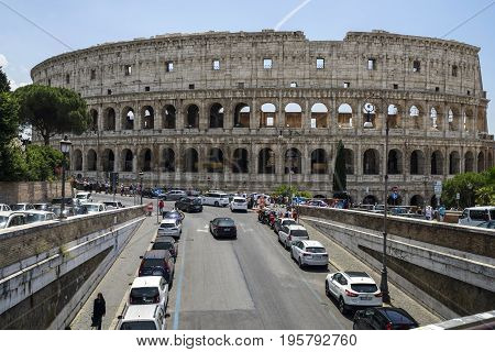 Colosseum in Rome Italy Europe June 2017 Flavirian Amphitheater. Ancient landmark. Street view and car traffic.