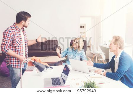 Mind exchange, Professional team of office workers sitting at the table and working in the office while discussing project