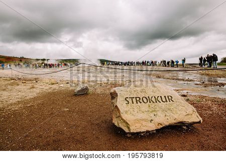 Sign of Strokkur fountain geyser in a geothermal area of Hvítá River in Iceland.Famous eruptive geyser and tourist attraction.Icelandic geothermal features,mud pools,fumaroles and Geysir geyser