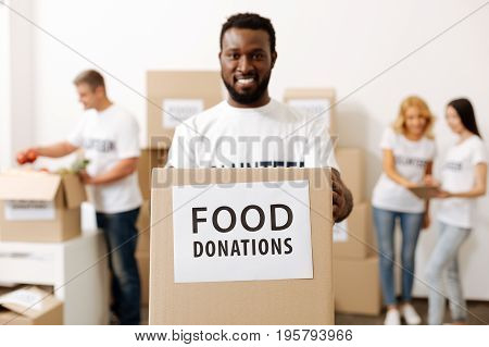 Plenty of work. Attractive passionate generous man working as a volunteer and shipping food supplies for those in need while helping the community