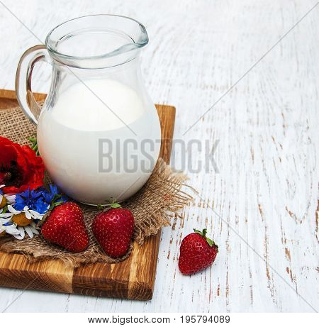 Jug With  Milk And Wildflowers