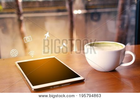 Green tea cup and icon on tablet in cafe shop time to relaxing hipster tone soft of focus
