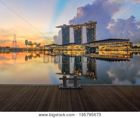 Singapore, Republic of Singapore - May 7, 2016: Marina Bay Sands hotel, ArtScience museum glowing at sunrise