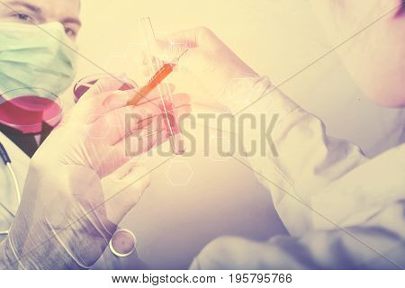 Double exposure of science experiment hand holding test tube in the lap
