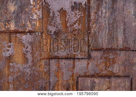 Old and rusty metal plate rivetsbackground