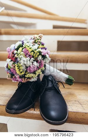 Wedding Bouquet On The Grooms Shoes