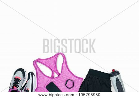 Sportswear With Sneakers, Smartphone, Fitness Tracker And Sports Bottle Isolated On White