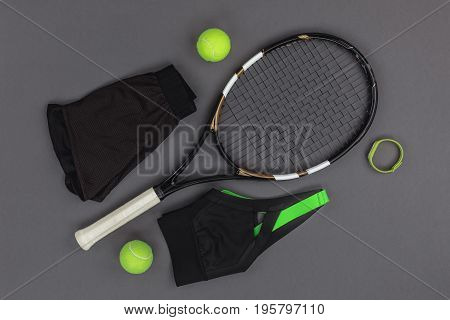 Top View Of Tennis Racquet And Balls, Sportswear And Fitness Tracker Isolated On Grey