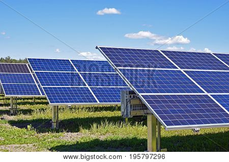 Row of solar panels on field. Horizontal image.