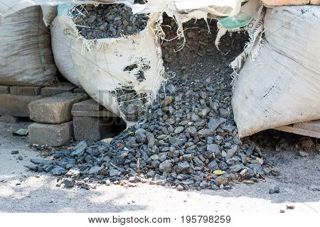 Coal in a bag on the street