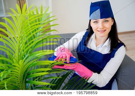 A portrait of a woman of cleaning service
