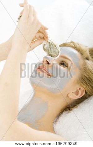 Nice blond woman having a face massage