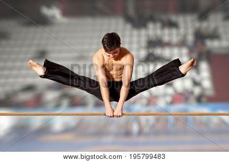Gymnast competing on high horizontal bar