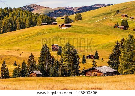 Fabulous mountain valley. The famous winter ski resort in autumn. The concept of an active and eco-tourism. The natural landscape of the Alps di Siusi