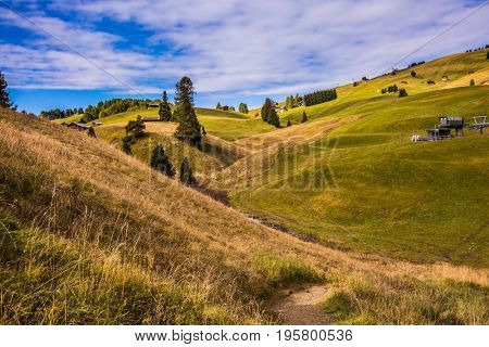 The landscape of the Alps di Siusi. The winter resort in autumn in mountain valley. The concept of an active and eco-tourism